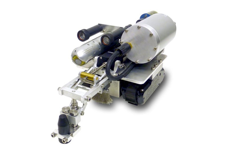 The MicroMag UT Probe and Wire brush is a high-performance easy-to-use accessory for the standard MicroMag crawler to support highly accurate ultrasonic thickness measurements of underwater ferrous metal surfaces. It can also be used in air with a couplant. The standard probe included with the Inuktun MicroMag is the Industrial Cygnus Mini ROV UT probe, which offers sound velocities between 1000m/s and 9995m/s, with accuracy of 0.1mm. Resolution is 0.05mm, and the frequency is 2.25MHz for measuring steel thicknesses between 3mm-250mm. Options are available in 3.5 MHz (2mm-150mm) or 5.0MHz (1mm-50mm). The probe is fully integrated with InunktunÕs Versatrax controller and video display functions and its multiple echo transducer enables fast and reliable measurements on surfaces that are heavily corroded and/or coated.